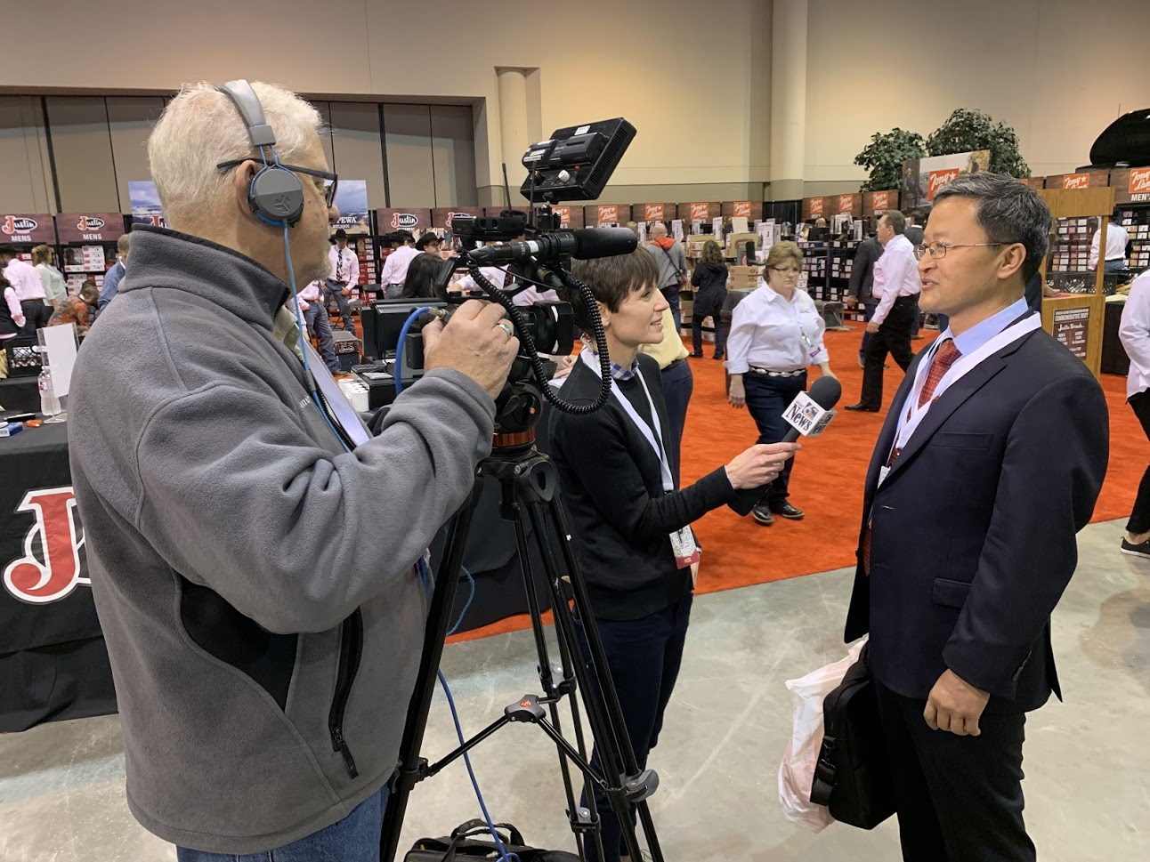 GuruFocus founder Dr. Charlie Tian being interviewed at Berkshire Hathaway's annual shareholder meeting.